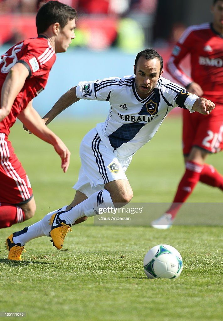<a gi-track='captionPersonalityLinkClicked' href=/galleries/search?phrase=Landon+Donovan&family=editorial&specificpeople=171601 ng-click='$event.stopPropagation()'>Landon Donovan</a> #10 of the Los Angeles Galaxy defends in an MLS game against the Toronto FC on March 30, 2013 at BMO Field in Toronto, Ontario, Canada. The Los Angeles Galaxy and Toronto FC played to a 2-2 tie.