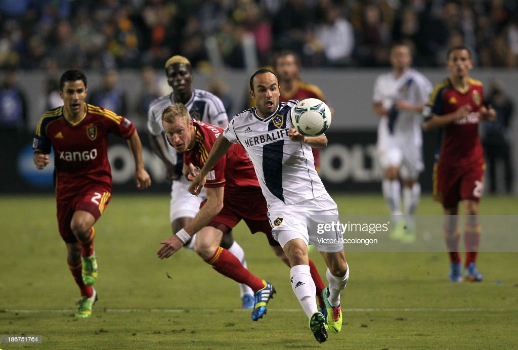 Landon Donovan of the Los Angeles Galaxy paces the ball on the attack past Tony Beltran and Nat Borchers of Real Salt Lake in the first half during...