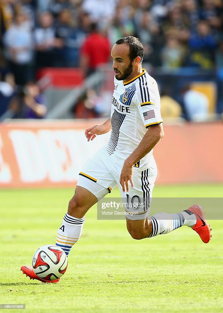 Landon Donovan #10 of the Los Angeles Galaxy paces the ball on the attack against the New England Revolution during 2014 MLS Cup at StubHub Center on December 7, 2014 in Los Angeles, California. The Galaxy defeated the Revolution 2-1.