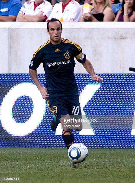 Landon Donovan of the Los Angeles Galaxy plays the ball against the New York Red Bulls during the game at Red Bull Arena on August 14 2010 in...
