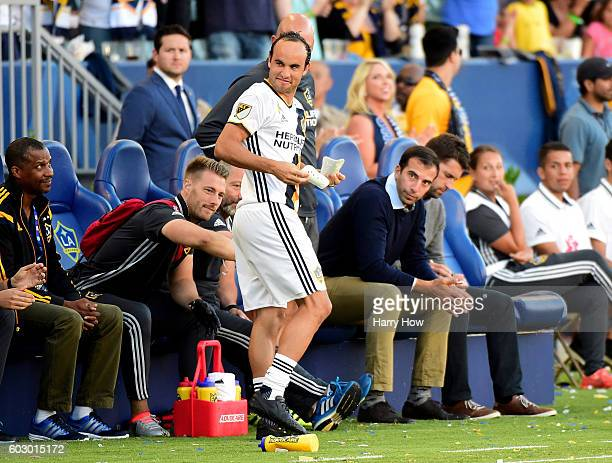 Landon Donovan of the Los Angeles Galaxy reacts as he prepares to enter the game against the Orlando City FC returning from retirement against the...