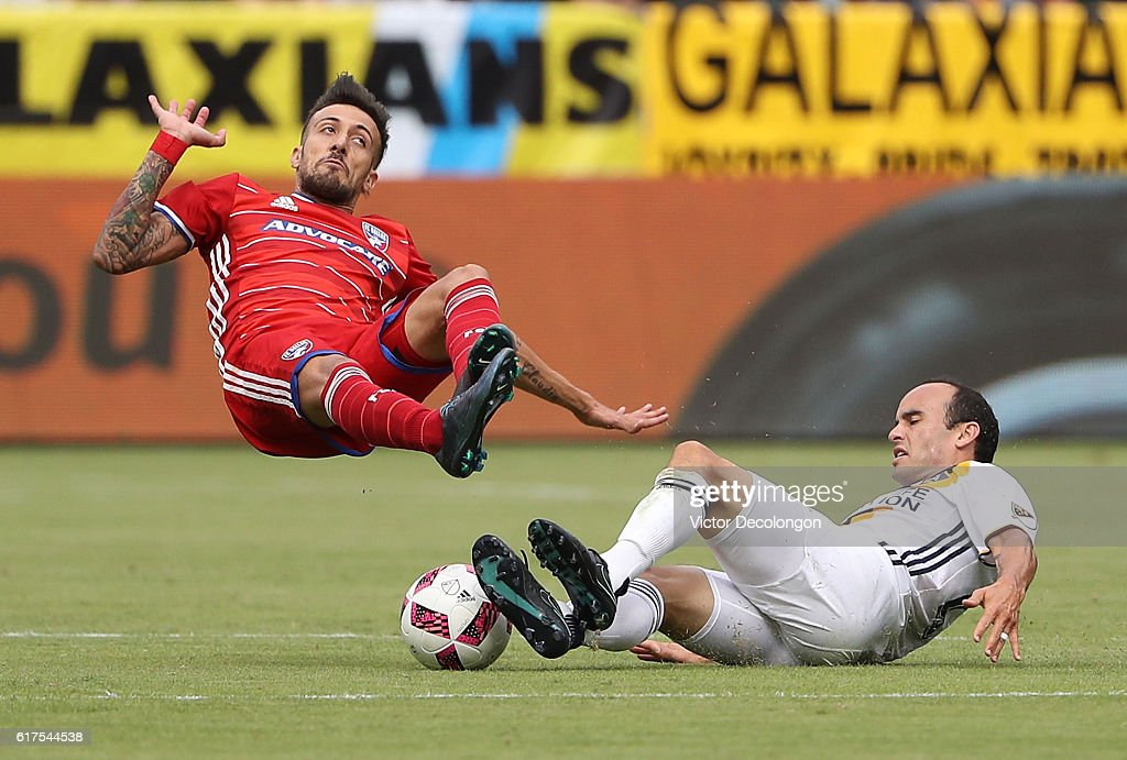 Landon Donovan #26 of the Los Angeles Galaxy tackles Maximiliano Urruti #37 of FC Dallas during the MLS match at StubHub Center on October 23, 2016 in Carson, California.