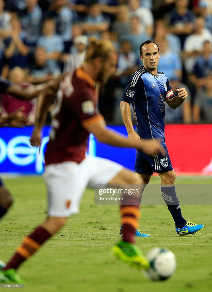 <a gi-track='captionPersonalityLinkClicked' href=/galleries/search?phrase=Landon+Donovan&family=editorial&specificpeople=171601 ng-click='$event.stopPropagation()'>Landon Donovan</a> #7 of the MLS All-Stars watches <a gi-track='captionPersonalityLinkClicked' href=/galleries/search?phrase=Federico+Balzaretti&family=editorial&specificpeople=686070 ng-click='$event.stopPropagation()'>Federico Balzaretti</a> #42 of AS Roma control the ball during the 2013 Major League Soccer All Star Game at Sporting Park on July 31, 2013 in Kansas City, Kansas.