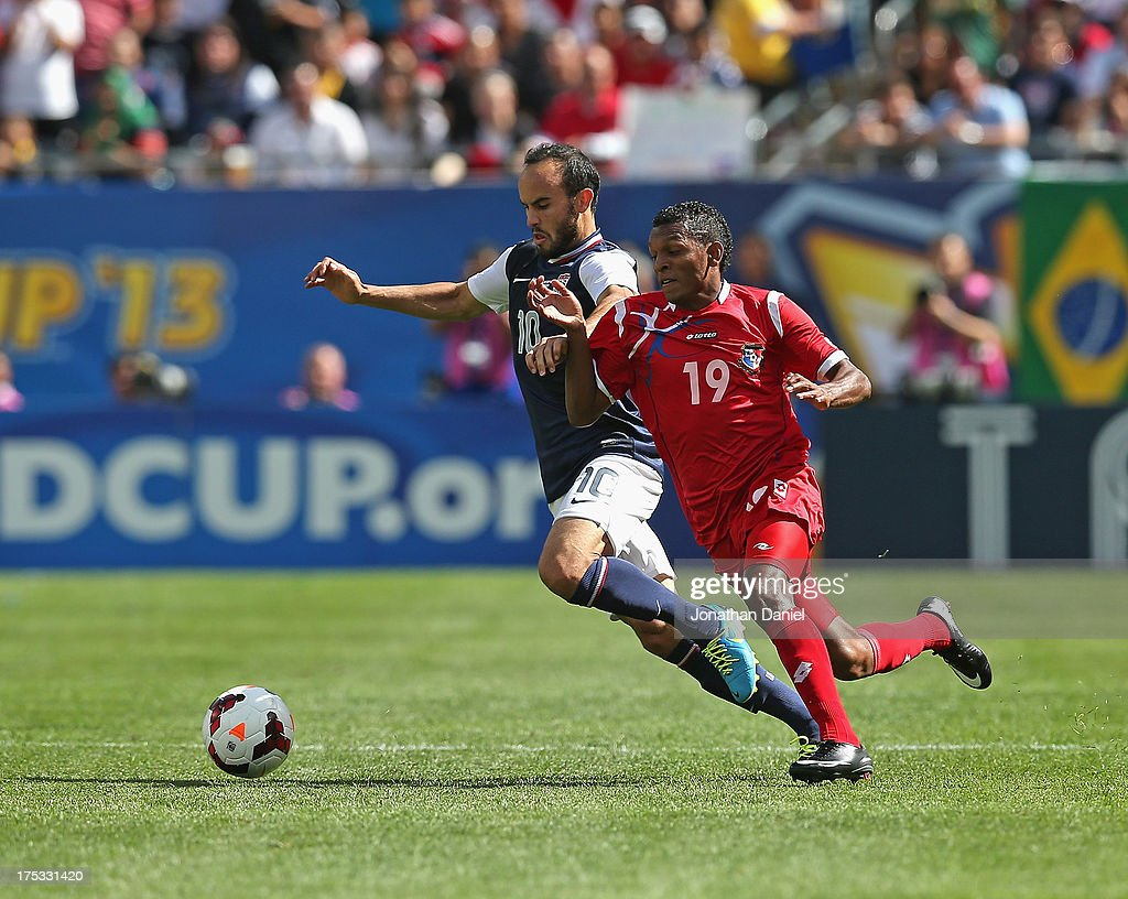 Landon Donovan #10 of the United States battles with Alberto Quintero #19 of Panama during the CONCACAF Gold Cup final match at Soldier Field on July 28, 2013 in Chicago, Illinois. The United States defeated Panama 1-0.