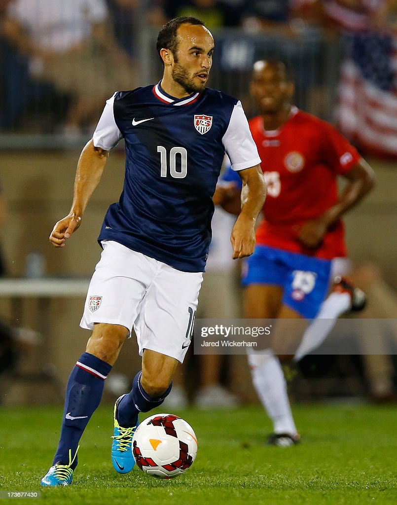 <a gi-track='captionPersonalityLinkClicked' href=/galleries/search?phrase=Landon+Donovan&family=editorial&specificpeople=171601 ng-click='$event.stopPropagation()'>Landon Donovan</a> #10 of the United States carries the ball against Costa Rica during the CONCACAF Gold Cup match at Rentschler Field on July 16, 2013 in East Hartford, Connecticut.