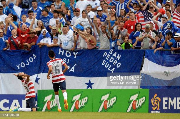 Landon Donovan of the United States celebrates after scoring a goal against El Salvador in the second half during the 2013 CONCACAF Gold Cup...