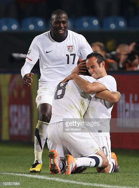 Landon Donovan of the United States celebrates scoring the winning goal with team mates Clint Dempsey and Jozy Altidore that sends the USA through to...