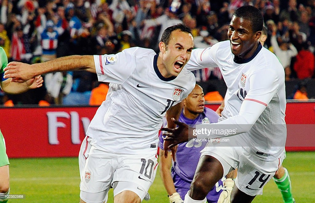 <a gi-track='captionPersonalityLinkClicked' href=/galleries/search?phrase=Landon+Donovan&family=editorial&specificpeople=171601 ng-click='$event.stopPropagation()'>Landon Donovan</a> of the United States celebrates with teammate <a gi-track='captionPersonalityLinkClicked' href=/galleries/search?phrase=Edson+Buddle&family=editorial&specificpeople=537919 ng-click='$event.stopPropagation()'>Edson Buddle</a> after scoring the winning goal that sends the USA through to the second round during the 2010 FIFA World Cup South Africa Group C match between USA and Algeria at the Loftus Versfeld Stadium on June 23, 2010 in Tshwane/Pretoria, South Africa.