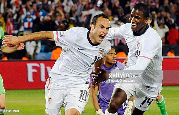 Landon Donovan of the United States celebrates with teammate Edson Buddle after scoring the winning goal that sends the USA through to the second...