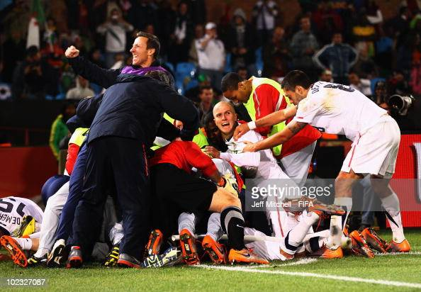 Landon Donovan of the United States is mobbed by teammates after scoring the winning goal against Algeria during the 2010 FIFA World Cup South Africa...