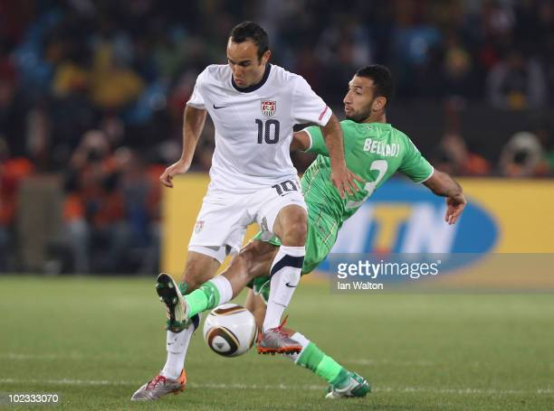 Landon Donovan of the United States is tackled by Nadir Belhadj of Algeria during the 2010 FIFA World Cup South Africa Group C match between USA and...