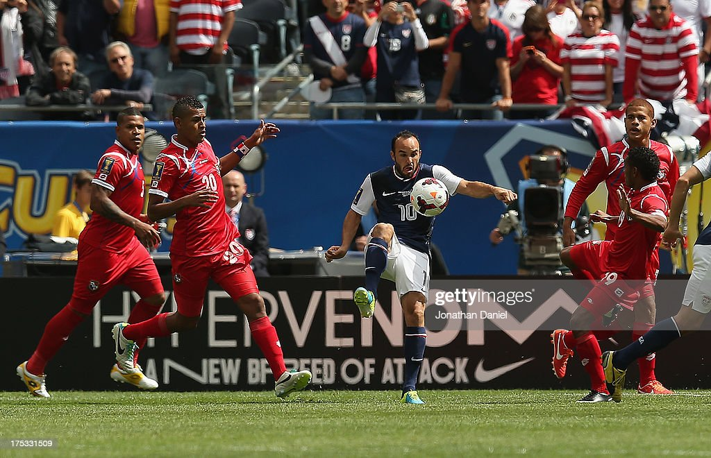 Landon Donovan #10 of the United States passes between members of Panama during the CONCACAF Gold Cup final match at Soldier Field on July 28, 2013 in Chicago, Illinois. The United States defeated Panama 1-0.