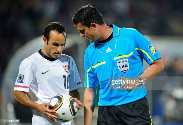 Landon Donovan of the United States speaks to Referee Viktor Kassai with the Jabulani match ball during the 2010 FIFA World Cup South Africa Round of...