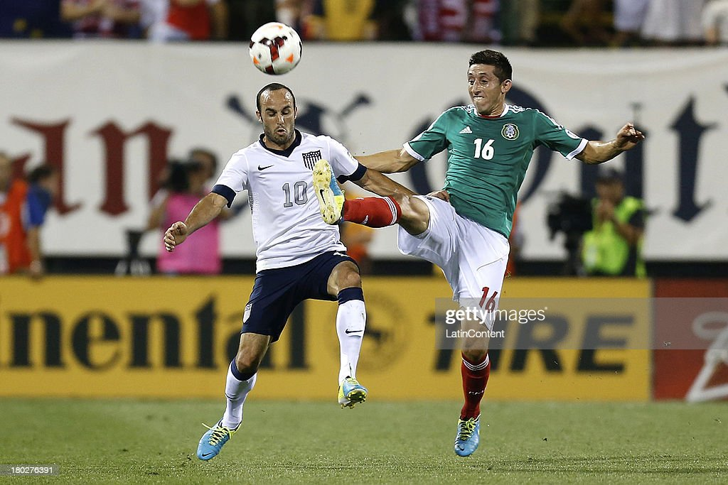 <a gi-track='captionPersonalityLinkClicked' href=/galleries/search?phrase=Landon+Donovan&family=editorial&specificpeople=171601 ng-click='$event.stopPropagation()'>Landon Donovan</a> of the US and Hector Herrera of Mexico fight for the ball during a match between United States and Mexico as part of the CONCACAF Qualifiers at Columbus Crew Stadium on September 10, 2013 in Columbus, United States.
