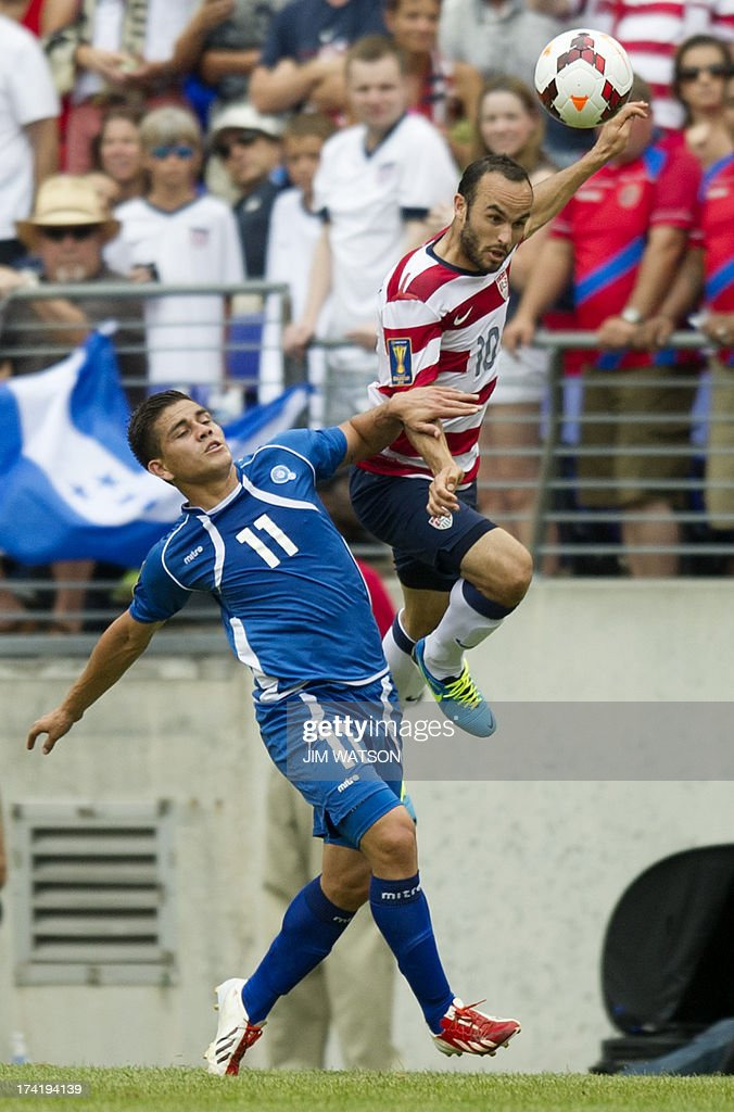 Landon Donovan of the US vies for a header with El Salvador's Rodolfo Zelaya Garcia during a CONCACAF quarterfinal match in Baltimore on July 21 2013...