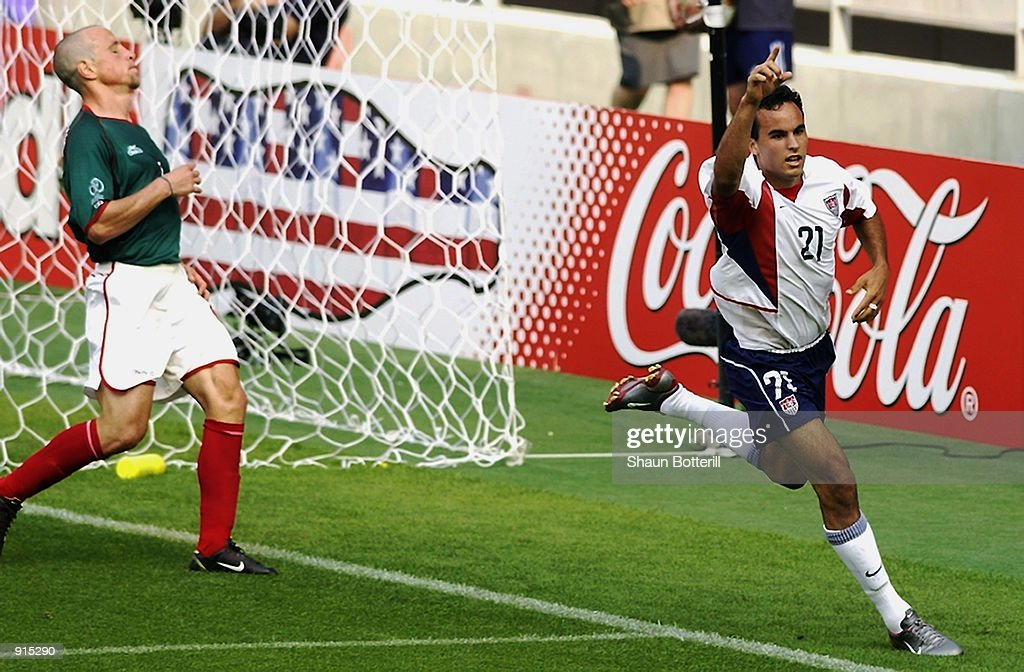 <a gi-track='captionPersonalityLinkClicked' href=/galleries/search?phrase=Landon+Donovan&family=editorial&specificpeople=171601 ng-click='$event.stopPropagation()'>Landon Donovan</a> of the USA celebrates scoring the second goal during the Mexico v USA, World Cup Second Round match played at the Jeonju World Cup Stadium, Jeonju, South Korea on June 17, 2002. The USA won 2-0.