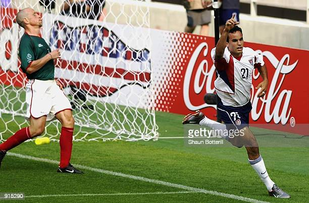 Landon Donovan of the USA celebrates scoring the second goal during the Mexico v USA World Cup Second Round match played at the Jeonju World Cup...