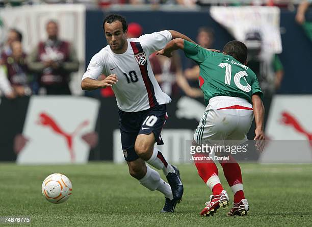 Landon Donovan of the USA controls the ball against Jamie Lozano of Mexico during the CONCACAF Gold Cup Final match at Soldier Field on June 24 2007...