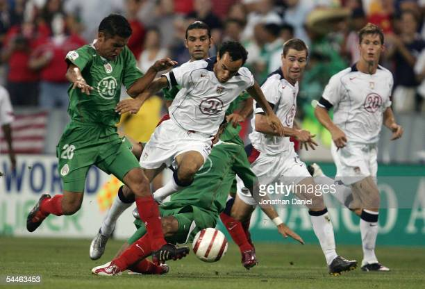 Landon Donovan of the USA tries to run through the defense Gerardo Galindo of Mexico as teammates Brian Ralston and Brian McBride look on during...
