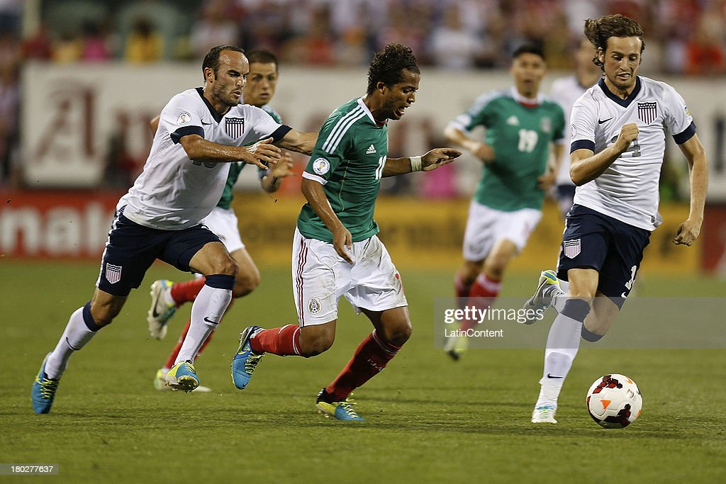 <a gi-track='captionPersonalityLinkClicked' href=/galleries/search?phrase=Landon+Donovan&family=editorial&specificpeople=171601 ng-click='$event.stopPropagation()'>Landon Donovan</a> of USA grabs Giovani Dos Santos of Mexico during a match between United States and Mexico as part of the CONCACAF Qualifiers at Columbus Crew Stadium on September 10, 2013 in Columbus, United States.