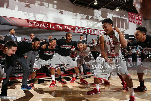 Landon Drew of the Cal State Northridge Matadors dances as he huddles with teammates Robert Cid KJ Smith Aaron Parks Trevone Williams Stephan Hicks...