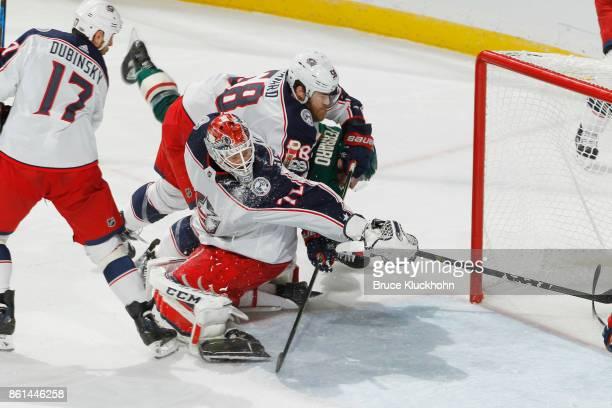 Landon Ferraro of the Minnesota Wild scores a goal with David Savard and goalie Sergei Bobrovsky of the Columbus Blue Jackets defending during the...
