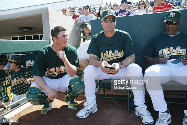 Landon Powell manager Bob Geren and Ty Waller of the Oakland Athletics during the game against the Cleveland Indians at the Phoenix Municpal Stadium...