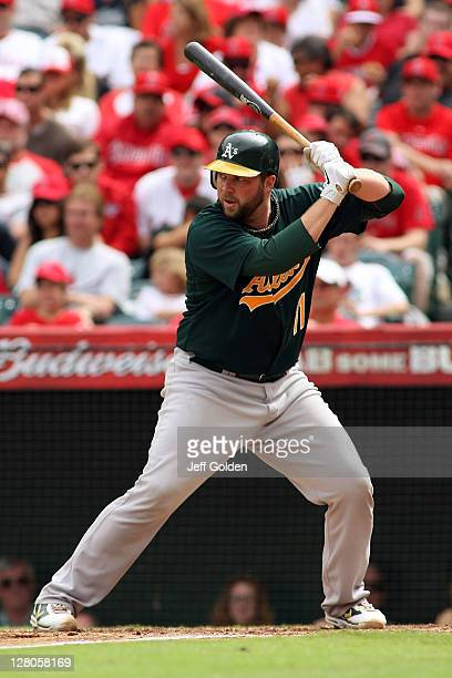 Landon Powell of the Oakland Athletics bats against the Los Angeles Angels of Anaheim in the sixth inning at Angel Stadium of Anaheim on September 25...
