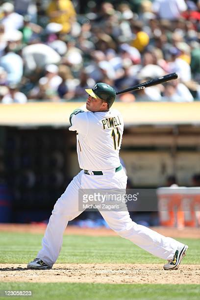 Landon Powell of the Oakland Athletics bats during the game against the Texas Rangers at the OaklandAlameda County Coliseum on August 13 2011 in...
