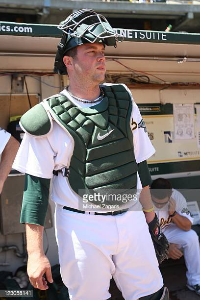 Landon Powell of the Oakland Athletics gets ready to take the field prior the game against the Texas Rangers at the OaklandAlameda County Coliseum on...