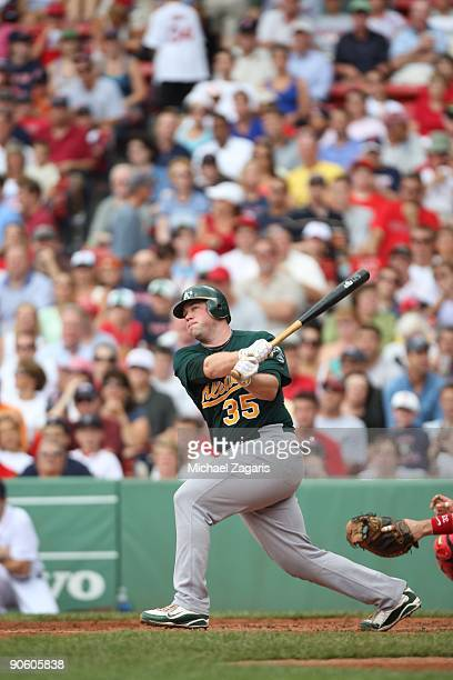 Landon Powell of the Oakland Athletics swings at a pitch during the game against the Boston Red Sox at Fenway Park on July 30 2009 in Boston...