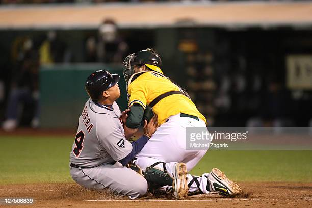 Landon Powell of the Oakland Athletics tags out Miguel Cabrera of the Detorit Tigers at home during the game at the OaklandAlameda County Coliseum on...