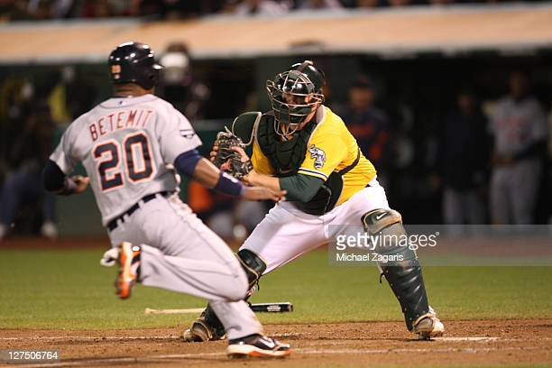 Landon Powell of the Oakland Athletics tags out Wilson Betemit of the Detroit Tigers out at home at the OaklandAlameda County Coliseum on September...