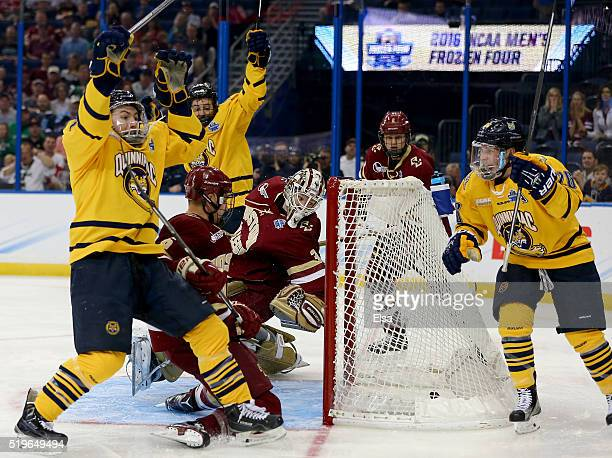 Landon Smith of the Quinnipiac Bobcats celebrates his goal with teammate Travis St Denis as Thatcher Demko of the Boston College Eagles is unable to...