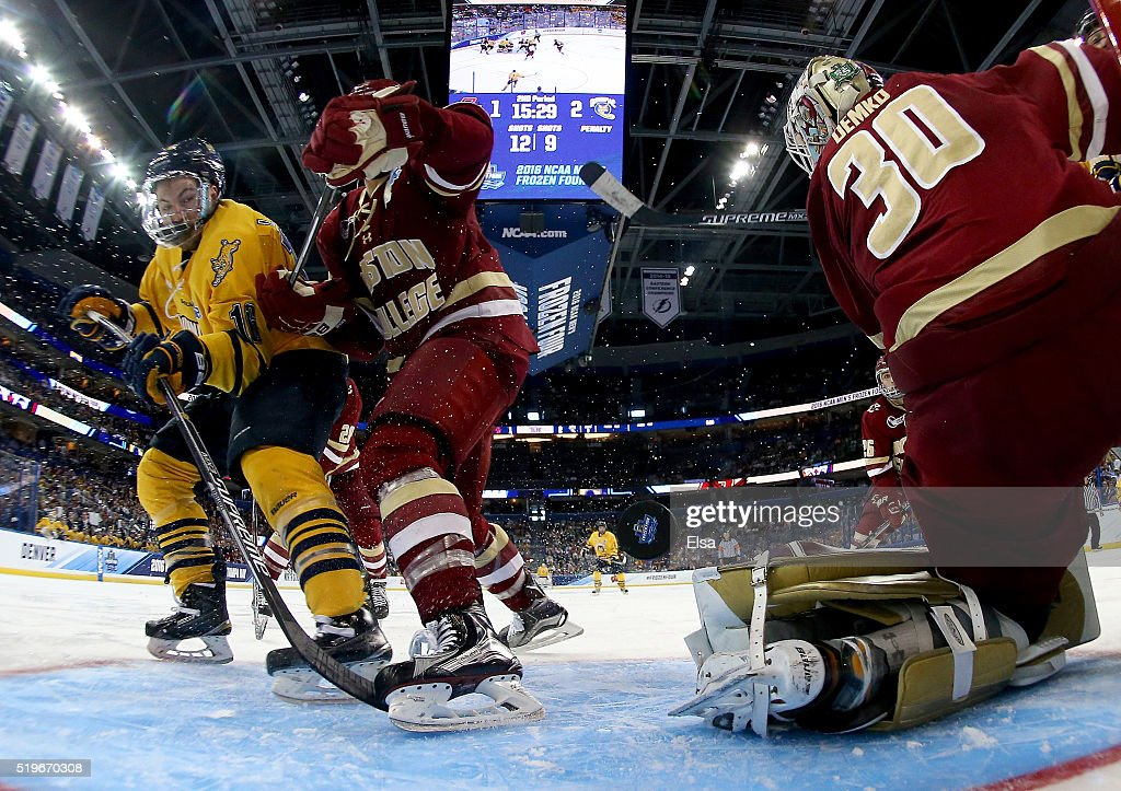 Landon Smith #16 of the Quinnipiac Bobcats gets the puck past Steve Santini #6 and Thatcher Demko #30 of the Boston College Eagles the second period during semifinals of the 2016 NCAA Division I Men's Hockey Championships at Amalie Arena on April 7, 2016 in Tampa, Florida.