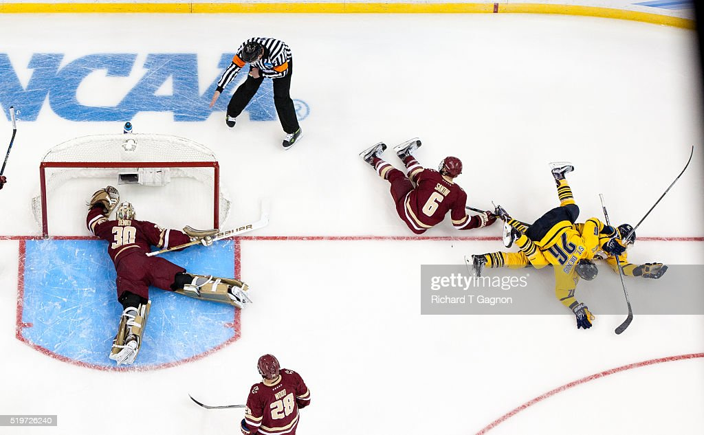 Landon Smith #16 of the Quinnipiac University Bobcats celebrates his goal against Thatcher Demko #30 of the Boston College Eagles with his teammate Travis St. Denis #26 during game two of the 2016 NCAA Division I Men's Hockey Frozen Four Championship Semifinal at the Amaile Arena on April 7, 2016 in Tampa, Florida. The Bobcats won 3-2.