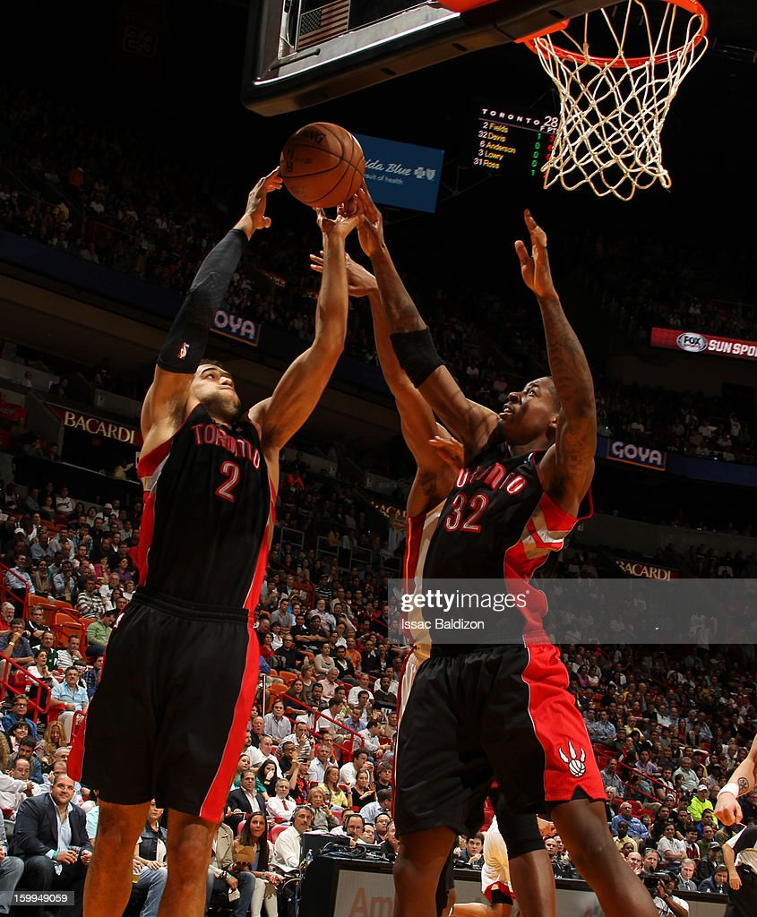 Landry Fields #2 and Ed Davis #32 of the Toronto Raptors go up for a rebound against the Miami Heat on January 23, 2013 at American Airlines Arena in Miami, Florida.