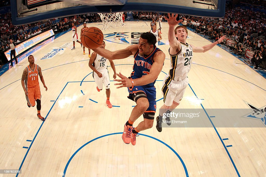 Landry Fields of the New York Knicks and Team Shaq drives for a shot attempt against Gordon Hayward of the Utah Jazz and Team Chuck during the BBVA...