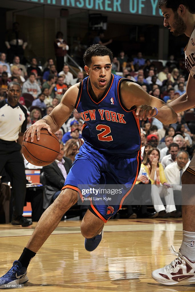 <a gi-track='captionPersonalityLinkClicked' href=/galleries/search?phrase=Landry+Fields&family=editorial&specificpeople=4184645 ng-click='$event.stopPropagation()'>Landry Fields</a> #2 of the New York Knicks drives to the basket against <a gi-track='captionPersonalityLinkClicked' href=/galleries/search?phrase=Omri+Casspi&family=editorial&specificpeople=2298404 ng-click='$event.stopPropagation()'>Omri Casspi</a> #36 of the Cleveland Cavaliers at The Quicken Loans Arena on April 20, 2012 in Cleveland, Ohio.