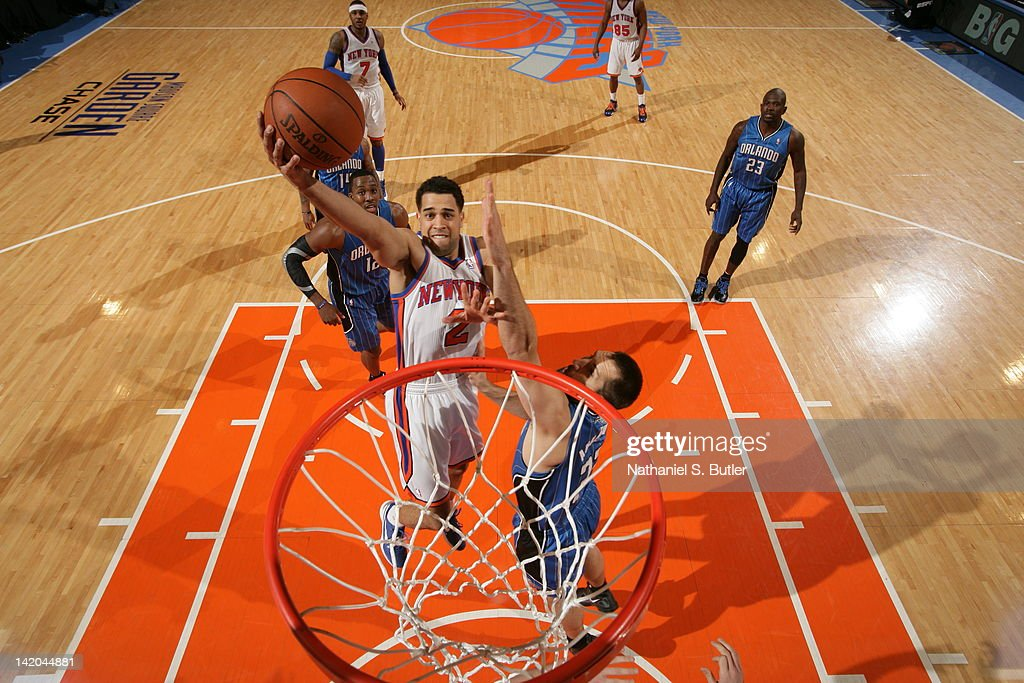 <a gi-track='captionPersonalityLinkClicked' href=/galleries/search?phrase=Landry+Fields&family=editorial&specificpeople=4184645 ng-click='$event.stopPropagation()'>Landry Fields</a> #2 of the New York Knicks goes to the basket against Ryan Anderson #33 of the Orlando Magic during the game on March 28, 2012 at Madison Square Garden in New York City.