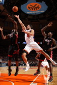 Landry Fields of the New York Knicks shoots against Joel Anthony of the Miami Heat during a game on January 27 2011 at Madison Square Garden in New...