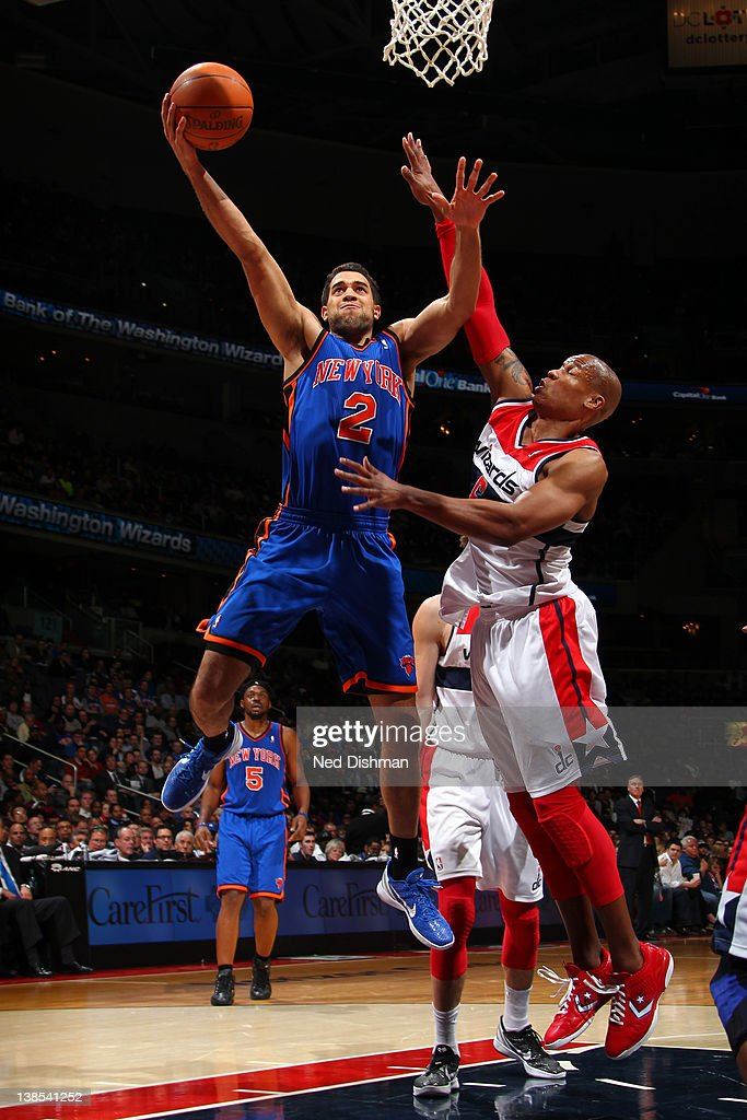 <a gi-track='captionPersonalityLinkClicked' href=/galleries/search?phrase=Landry+Fields&family=editorial&specificpeople=4184645 ng-click='$event.stopPropagation()'>Landry Fields</a> #2 of the New York Knicks shoots against Maurice Evnas #6 of the Washington Wizards during the game at the Verizon Center on February 8, 2012 in Washington, DC.