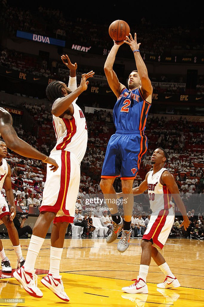 <a gi-track='captionPersonalityLinkClicked' href=/galleries/search?phrase=Landry+Fields&family=editorial&specificpeople=4184645 ng-click='$event.stopPropagation()'>Landry Fields</a> #2 of the New York Knicks shoots against <a gi-track='captionPersonalityLinkClicked' href=/galleries/search?phrase=Ronny+Turiaf&family=editorial&specificpeople=224998 ng-click='$event.stopPropagation()'>Ronny Turiaf</a> #21 of the Miami Heat in Game One of the Eastern Conference Quarterfinals during the 2012 NBA Playoffs on April 28, 2012 at American Airlines Arena in Miami, Florida.