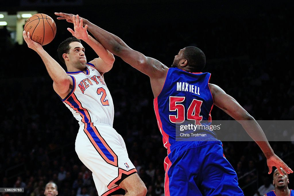 Landry Fields of the New York Knicks shoots over Jason Maxiell of the Detroit Pistons at Madison Square Garden on January 31 2012 in New York City...