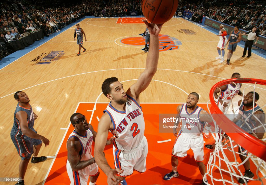<a gi-track='captionPersonalityLinkClicked' href=/galleries/search?phrase=Landry+Fields&family=editorial&specificpeople=4184645 ng-click='$event.stopPropagation()'>Landry Fields</a> #2 of the New York Knicks takes a shot during the game against the Charlotte Bobcats on January 4, 2012 at Madison Square Garden in New York City.