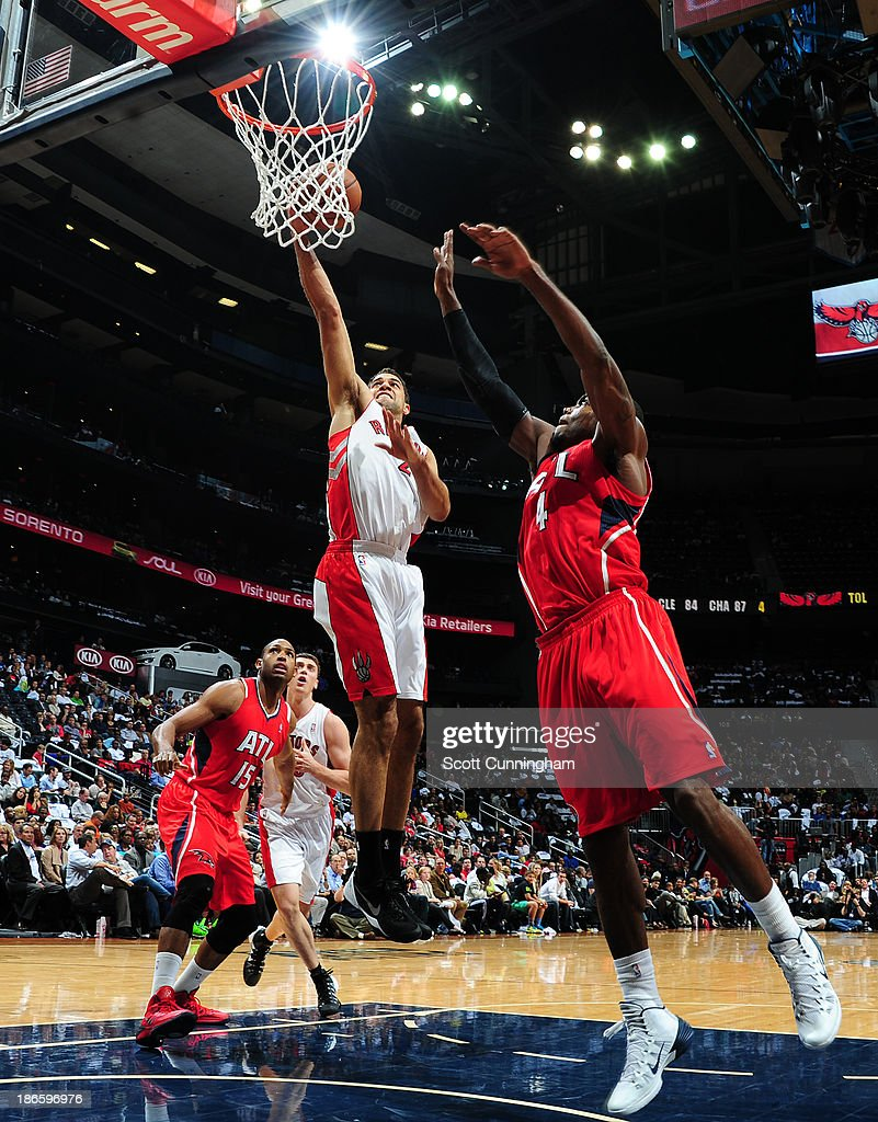 <a gi-track='captionPersonalityLinkClicked' href=/galleries/search?phrase=Landry+Fields&family=editorial&specificpeople=4184645 ng-click='$event.stopPropagation()'>Landry Fields</a> #2 of the Toronto Raptors drives to the basket against the Toronto Raptors on November 1, 2013 at Philips Arena in Atlanta, Georgia.