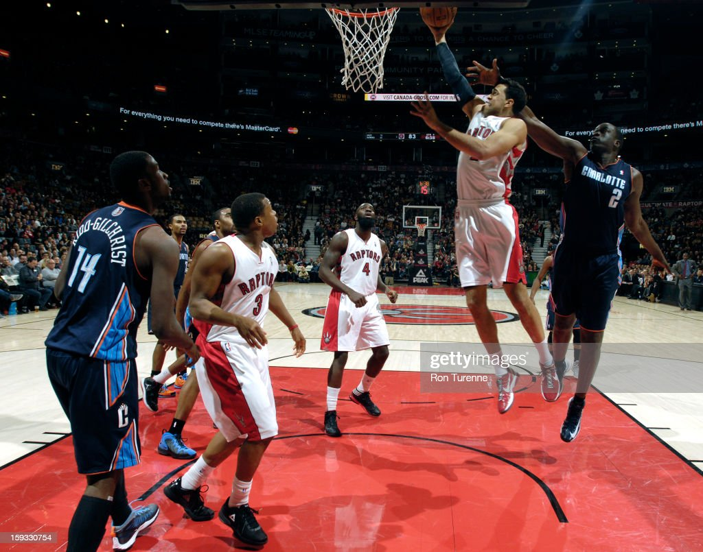 Landry Fields #2 of the Toronto Raptors goes up for the layup against DeSagana Diop #2 of Charlotte Bobcats during the game on January 11, 2013 at the Air Canada Centre in Toronto, Ontario, Canada.