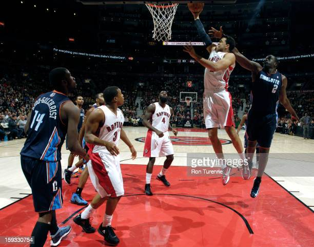 Landry Fields of the Toronto Raptors goes up for the layup against DeSagana Diop of Charlotte Bobcats during the game on January 11 2013 at the Air...