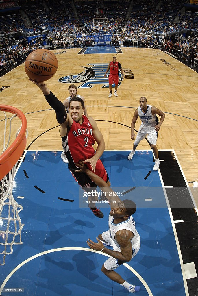 Landry Fields #2 of the Toronto Raptors goes up strong to the basket against the Orlando Magic during the game on December 29, 2012 at Amway Center in Orlando, Florida.