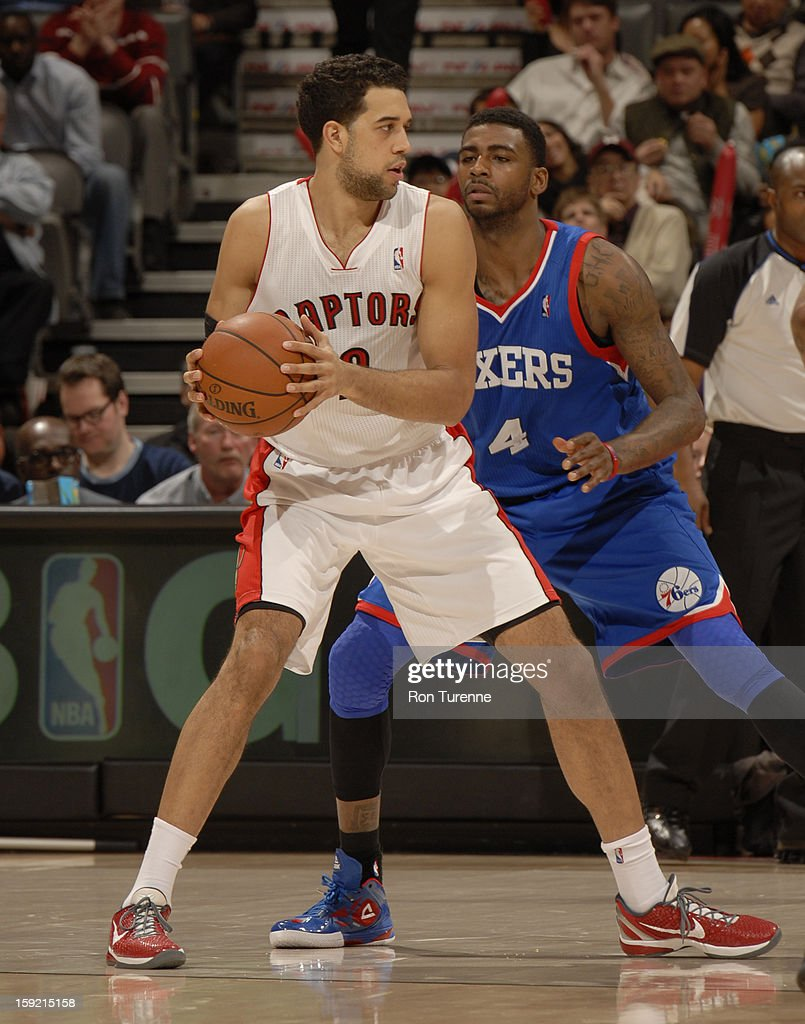<a gi-track='captionPersonalityLinkClicked' href=/galleries/search?phrase=Landry+Fields&family=editorial&specificpeople=4184645 ng-click='$event.stopPropagation()'>Landry Fields</a> #2 of the Toronto Raptors looks to pass the ball against <a gi-track='captionPersonalityLinkClicked' href=/galleries/search?phrase=Dorell+Wright&family=editorial&specificpeople=211344 ng-click='$event.stopPropagation()'>Dorell Wright</a> #4 of Philadelphia 76ers during the game on January 9, 2013 at the Air Canada Centre in Toronto, Ontario, Canada.